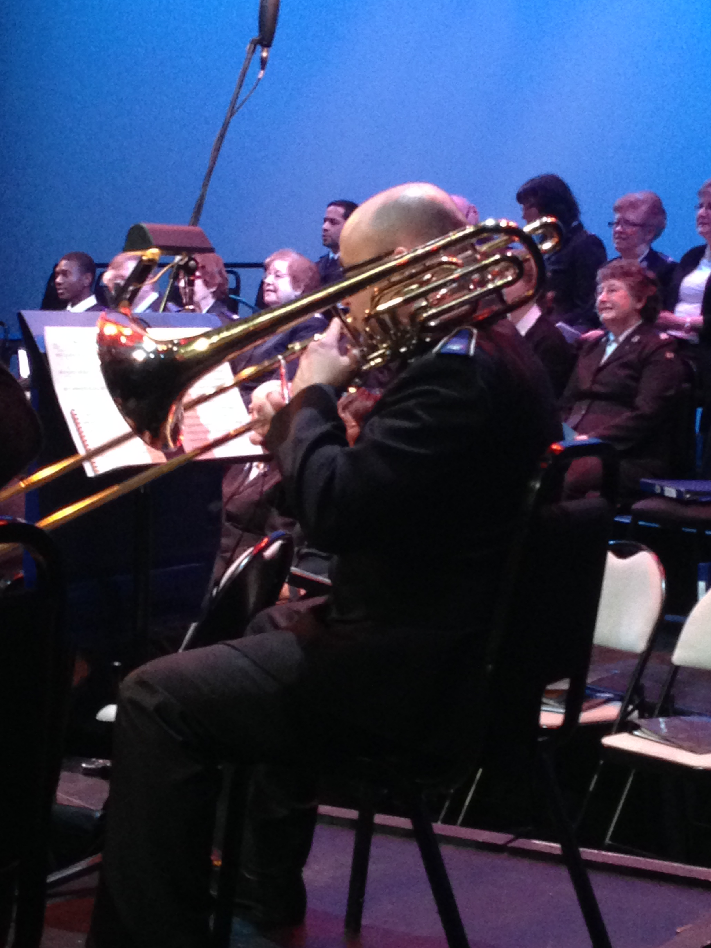 Image of man playing trombone in a symphony