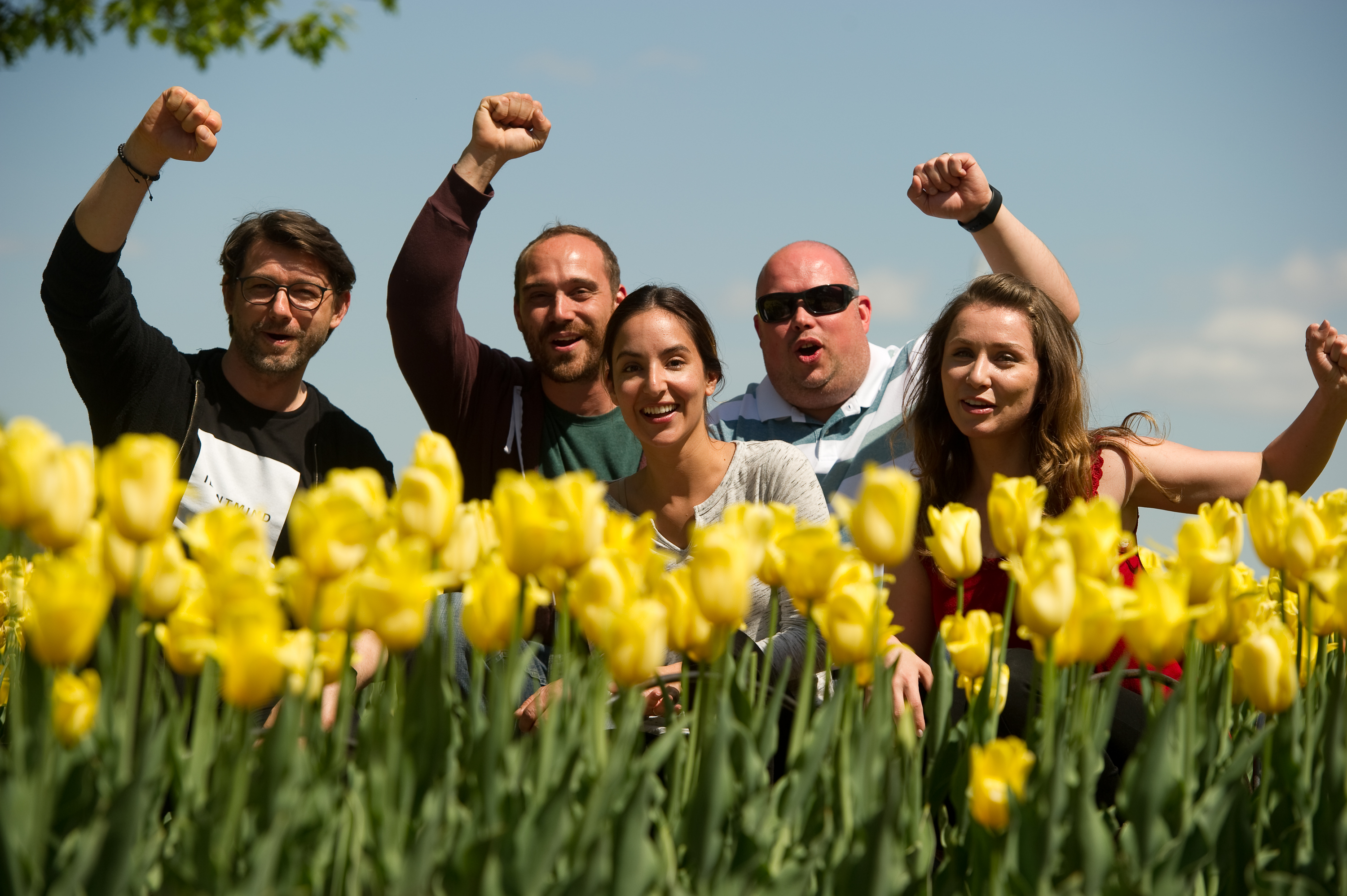 The OPIN web dvelopment team poses at Tulip Festival