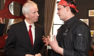 Former foreign affairs minister-turned-diplomat Stéphane Dion in conversation with Jesse Bell, executive chef of The Albion Rooms, on Thursday, March 23, 2017, at the grand opening celebration for the restaurant's new Heritage Room Gastropub at Novotel Ottawa. (Photo by Caroline Phillips)