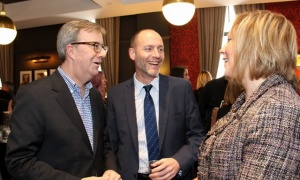 From left, Ottawa Mayor Jim Watson and Christopher Egan, CEO of the Financial Management Institute of Canada, in conversation with the Novotel's Tracey Parslow, director of sales and marketing, at the hotel's grand opening party of The Albion Rooms' new Heritage Room Gastropub on Thursday, March 23, 2017. (Photo by Caroline Phillips)