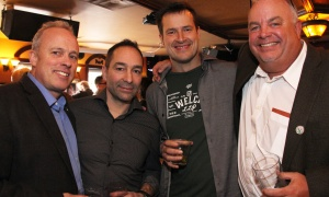 From left, Bob Watson, business development manager at Marathon Drilling, with builder Franco Marino, Bruce Raganold, ‎director of business development at Welch LLP, and Henry Brenning, owner of an asphalt paving company, at the Irish Canadian Saint Patrick's Week Luncheon held at the Heart & Crown Irish Pub in the ByWard Market on Friday, March 10, 2017. (Caroline Phillips / Ottawa Business Journal)