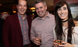 From left, Coun. Mathieu Fleury (Rideau-Vanier) with Adam O'Connor, manager of land development at McIntosh Perry Consulting Engineers Ltd., and Treasa Carolan, at the Irish Canadian Saint Patrick's Week Luncheon held at the Heart & Crown Irish Pub in the ByWard Market on Friday, March 10, 2017,  in support of such charities as the Bruyère Foundation. (Caroline Phillips / Ottawa Business Journal)