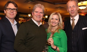 From left, Duncan Fraser, co-CEO and senior counsel with Heuristica Discovery Counsel, with Patrick Murray, a partner at McMillan LLP, Jamie-Lynn Pokrzywka, a sales rep with FLUX Lighting Inc., and Patrick Dion with Greenbridge Consulting Group at the Irish Canadian Saint Patrick's Week Luncheon held at the Heart & Crown Irish Pub in the ByWard Market on Friday, March 10, 2017. (Caroline Phillips / Ottawa Business Journal)