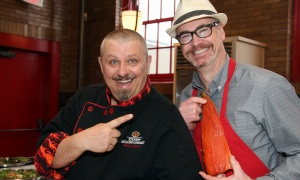 From right, Jim Foster from Pelican Fishery and Grill looks a little fishy as he hams it up with Steph Legari, owner of Steph the Grilling Gourmet, at a launch held Wednesday, April 19, 2017, at the Urban Element for the upcoming Taste for Life fundraiser in support of people living with HIV/AIDS. (Photo by Caroline Phillips)