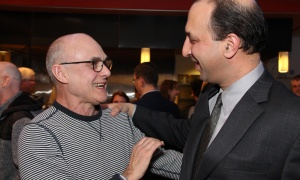 From left, Ottawa actor John Koensgen greets actor Sanjay Talwar, who plays the starring role of Joe Clark in Michael Healey's new political satire 1979, at its opening night party at the Great Canadian Theatre Company on Thursday, April 13, 2017. (Photo by Caroline Phillips)