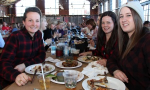 From left, Sidney Ritchie, Kristen MacDonald and Taylor Ambler, in similar lumberjack shirts, attended the Sugar Lumberfest, an urban sugar shack event held at the Horticulture Building at Lansdowne Park on Saturday, April 8, 2017. (Photo by Caroline Phillips)