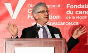 Dr. Hartley Stern, president of the Canadian Medical Protective Association and chair of the Cancer Champions Campaign, addresses the crowd at the Cancer Champions Breakfast held at the Ottawa Conference and Event Centre on Wednesday, May 10, 2017. (Photo by Caroline Phillips)