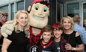 Big Joe, looking very photogenic, with, from left, Colleen McBride-O'Brien, Angus Albinati and Liam Bishop  at a benefit for CHEO's IBD Centre held at Ottawa Redblacks president Jeff Hunt's condo overlooking the football team's opening home game on Friday, June 23, 2017. (Photo by Caroline Phillips)