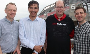 From left, medical researchers Alain Stintzi, Daniel Figeys, David Mack, director of the IBD Centre at CHEO, and Eric Benchimol -- during just a brief bit of rain -- at the Kick Off For Kids tailgate party for CHEO's IBD Centre, held on the home opening game of the Ottawa Redblacks at team president Jeff Hunt's condo, on Friday, June 23, 2017. (Photo by Caroline Phillips)