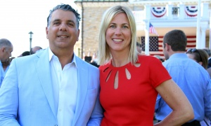 Ottawa philanthropist Gary Zed with Liza Mrak, executive vice-president of Mark Motors of Ottawa, at the U.S. Embassy's Fourth of July Celebration held at the official residence of the American ambassador on Tuesday, July 4, 2017. (Photo by Caroline Phillips)