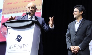 From left, gala honourary co-chairs Raj  Narula and Yasir Naqvi, the attorney general of Ontario, deliver their welcome remarks at NetIP Canada's 7th Diwali & Awards Gala, held at the Infinity Convention Centre on Friday, October 13, 2017. Photo by Caroline Phillips