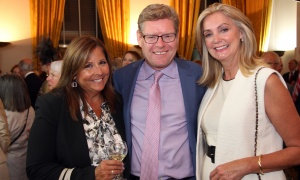 Ottawa divorce lawyer Andrea Camacho with Brian Murray, director of leasing and business development at Sakto Corporation,  with  school principal Shari Brodie at Soirée Salus, held at the Embassy of France on Thursday, October 5, 2017, in support of Ottawa Salus. Photo by Caroline Phillips