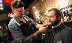 Eric Goncalves gets a shave and a cut  from Matthew Brousseau as part of the Movember Ottawa kick-off, held at the Capital Barber Shop in the Glebe on Wednesday, November 1, 2017. Photo by Caroline Phillips