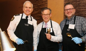From left, Ottawa Police Chief Charles Bordeleau, CTV Ottawa sports director Terry Marcotte and Michael Maidment, executive director of the Ottawa Food Bank, volunteered as servers at the Christmas Cheer Breakfast, held at the Westin Ottawa on Friday, December 8, 2017. Photo by Caroline Phillips