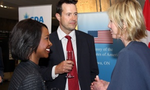 From left, Denise Siele with Bruce Raganold from Welch LLP in conversation with U.S. Ambassador Kelly Craft at the Macdonald-Laurier Institute dinner held at the Canadian War Museum on Tuesday, February 13, 2018. Photo by Caroline Phillips
