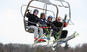 Spotted on the four-person chairlift are Marc Alward, organizing committee member Michael Renaud and former ski racer Kathy Thurley with the Eva Cope Foundation. Photo by Caroline Phillips