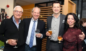 From left, Carman Joynt with Jeff Mierins, Bruce Raganold, director of business development for Welch LLP, and his wife, Giselle Bergeron-Raganold, at Gusto Worldwide Media's studio grand opening in Ottawa on Tuesday, April 3, 2018. Photo by Caroline Phillips