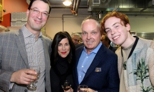 From left, Stephen Beckta and his wife, Maureen Cunningham, with Chris Knight and his son, Adam Knight, at Gusto Worldwide Media's studio grand opening in Ottawa on Tuesday, April 3, 2018. Photo by Caroline Phillips