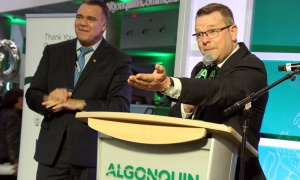 From left, Algonquin College grad Pierre Santoni, director of strategic partnerships and alliances at VIA Rail, with Gord Brown on stage for the live auction during the school's 50th anniversary gala, held Thursday, May 3, 2018. Photo by Caroline Phillips