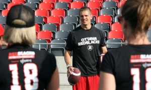 Ottawa Redblacks quarterback Trevor Harris gives women a lesson on how to throw a football at the Redblacks Women's Training Camp, held at TD Place Stadium on Tuesday, June 12, 2018. Photo by Caroline Phillips