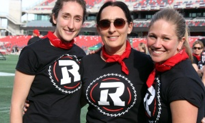 From left, Emily Segal with Tina Ages and Louise Malhotra  at the Redblacks Women's Training Camp, which raised funds through the OSEG Foundation to keep more girls active and healthy through sports programming. Photo by Caroline Phillips