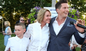U.S. Ambassador Kelly Craft is seen with Clifton Murray, a member of The Tenors, and a young guest  at the 4th of July Independence Day Celebration, hosted by the U.S. Embassy on Wednesday, July 4, 2018. Photo by Caroline Phillips