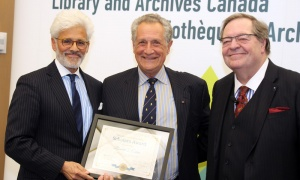 Bibliographer, historian and bibliophilic philanthropist Ronald I. Cohen, middle, receives his LAC Scholars Award from Jacques Shore, left, and Guy Berthiaume at Library and Archives Canada on Tuesday, April 2, 2019. Photo by Caroline Phillips