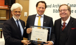 Canadian novelist, essayist and memoirist Lawrence Hill received his LAC Scholars Award from Jacques Shore, left, and Guy Berthiaume at Library and Archives Canada on Tuesday, April 2, 2019. Photo by Caroline Phillips
