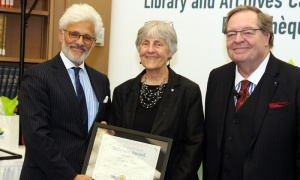 Canadian writer, poet and essayist Frances Itani receives her LAC Scholars Award from Jacques Shore, left, and Guy Berthiaume at Library and Archives Canada on Tuesay, April 2, 2019. Photo by Caroline Phillips