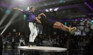 Partygoers were treated to an acrobatic roller-skating performance at The Infinity Ball. Photo by Caroline Phillips