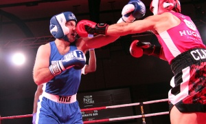 From left, Kyle Turk takes one in the face from Jeff Clarke at Fight for the Cure, held at the Hilton Lac-Leamy on Saturday, Oct. 19, 2019. Photo by Caroline Phillips