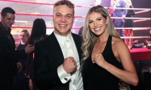 Top fundraiser Jeff Clarke, after his white-collar boxing match, does the classic fight pose with his girlfriend, Susy Lee, marketing coordinator at TRUEdotDESIGN, at Fight for the Cure. Photo by Caroline Phillips