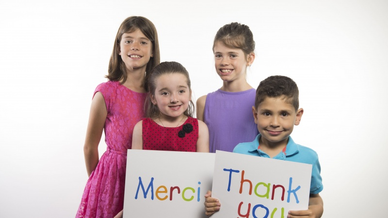 Children with thank you signs
