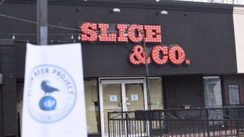 The windows of Slice and Co. have been papered up for months. The owners are getting ready to rebrand the pizzeria as a craft beer bar.