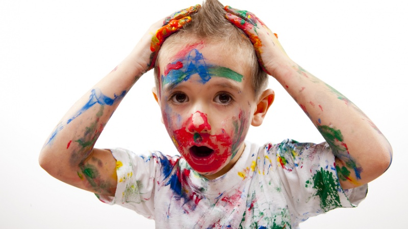 A child covered in paint.
