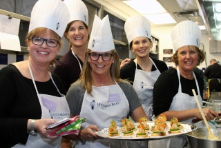 From left, communications professional Kim Haliburton with Colleen Daly, Jane Forsyth (Royal LePage Performance Realty), Danielle Mulaire (Export Development Canada) and Jennifer Godfrey in the kitchen at Le Cordon Bleu for United Way Ottawa's inaugural Food Fusion cooking competition held Thursday, March 30, 2017. (Photo by Caroline Phillips)