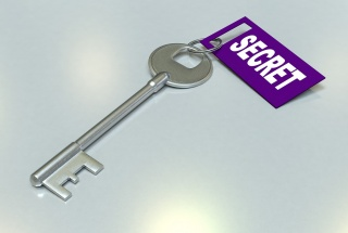 "A key with a tag reading ""secret"" on it"